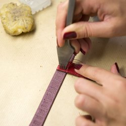 Leather Strap - Hermès - Tapping in the holes for stitching