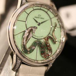 The intricately engraved birds on the Jaquet Droz Bird Repeater Geneva watch